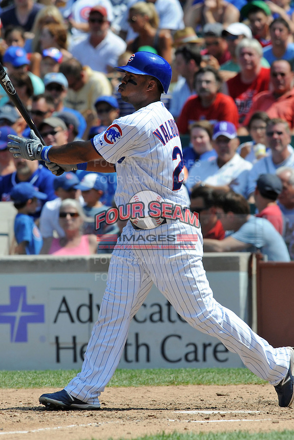 Chicago Cubs third baseman Luis Valbuena #24 swings at a pitch during a game against the Arizona Diamondbacks at Wrigley Field on July 15, 2012 in Chicago, Illinois. The Cubs defeated the Diamondbacks 3-1. (Tony Farlow/Four Seam Images).