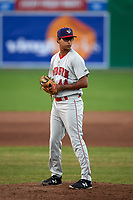 Auburn Doubledays relief pitcher Angel Guillen (44) gets ready to deliver a pitch during a game against the Batavia Muckdogs on June 28, 2018 at Dwyer Stadium in Batavia, New York.  Auburn defeated Batavia 14-9.  (Mike Janes/Four Seam Images)