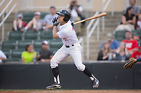 Frank Califano (22) of the Kannapolis Intimidators follows through on his swing against the Asheville Tourists at Intimidators Stadium on May 28, 2016 in Kannapolis, North Carolina.  The Intimidators defeated the Tourists 5-4 in 10 innings.  (Brian Westerholt/Four Seam Images)