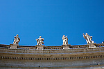 Statues line the battlements at  St. Peters Cathederal.
