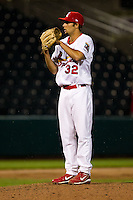 Nick Greenwood (32) of the Springfield Cardinals reads the pitch sign during a game against the Frisco RoughRiders on April 14, 2011 at Hammons Field in Springfield, Missouri.  Photo By David Welker/Four Seam Images.