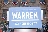 A Warren campaign sign hangs on a podium before Elizabeth Warren's speech announcing her candidacy for the 2020 presidential election at Everett Mills, site of the 1912 Bread and Roses strike, in Lawrence, Massachusetts, USA, on Sat., Feb. 9, 2019.