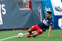 FOXBOROUGH, MA - AUGUST 8: Brando Bye #15 of New England Revolution slides to keep ball in play during a game between Philadelphia Union and New England Revolution at Gillette Stadium on August 8, 2021 in Foxborough, Massachusetts.