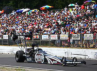 Aug. 2, 2014; Kent, WA, USA; NHRA top fuel dragster driver Shawn Langdon on the return road during qualifying for the Northwest Nationals at Pacific Raceways. Mandatory Credit: Mark J. Rebilas-