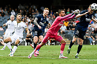 3rd January 2021; Campbelltown Stadium, Leumeah, New South Wales, Australia; A League Football, Macarthur FC versus Central Coast Mariners; Mark Birighitti of Central Coast Mariners sets to punch the ball as Kye Rowles of Mariners clears the danger