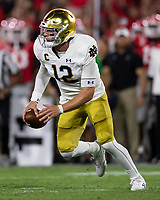 ATHENS, GA - SEPTEMBER 21: Ian Book #12 of the Notre Dame Fighting Irish runs with the ball during a game between Notre Dame Fighting Irish and University of Georgia Bulldogs at Sanford Stadium on September 21, 2019 in Athens, Georgia.