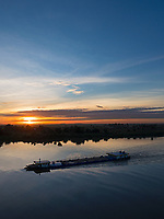 Sunrise and the Bassac River this river is a  distributary of the Tonlé Sap and Mekong River River from a Bridge in Phnom Penh, Cambodia