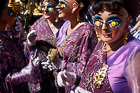 Women wearing elaborate costumes dance at the Carnaval de Oruro. During the fiesta many people sacrifice llamas and give offerings such as coca leaves and cigarettes to show their dedication to the Devil, a Virgin, Pachamama or Mother Earth. The Devil (or Uncle) is a mythical character that protects the miners of Oruro who work in dangerous conditions hundreds of metres below the ground. During the carnival, people dress in outrageous costumes and dance for days before arriving at the Church of Socavon, where they pay their respects to a virgin. Ironically, many of the dancers wear devil costumes.