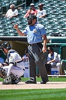 Umpire Bryan Fields handles the calls behind the plate during the Pacific Coast League game between the Salt Lake Bees and the El Paso Chihuahuas at Smith's Ballpark on July 26, 2015 in Salt Lake City, Utah.  El Paso defeated Salt Lake 6-3 in 10 innings. (Stephen Smith/Four Seam Images)