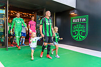 AUSTIN, TX - JUNE 19: Alex Ring #8 of Austin FC and kids enter the pitch before a game between San Jose Earthquakes and Austin FC at Q2 Stadium on June 19, 2021 in Austin, Texas.