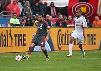 Toronto, Ontario - May 3, 2014: Toronto FC midfielder Dwayne De Rosario #14 and New England Revolution forward Teal Bunbury #10 in action during a game between the New England Revolution and Toronto FC at BMO Field.<br /> The New England Revolution won 2-1.