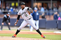 Augusta GreenJackets starting pitcher Gregory Santos (32) delivers a pitch during a game against the Asheville Tourists at McCormick Field on April 5, 2019 in Asheville, North Carolina. The  Tourists defeated the GreenJackets 5-0. (Tony Farlow/Four Seam Images)