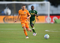 LAKE BUENA VISTA, FL - JULY 18: Adam Lundkvist #3 of the Houston Dynamo passes the ball during a game between Houston Dynamo and Portland Timbers at ESPN Wide World of Sports on July 18, 2020 in Lake Buena Vista, Florida.