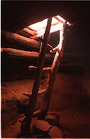 """""""Perfect Kiva"""".Located in Southern Utah in Grand Gulch.this Kayenta Anazasi ruin has been reroofed by the NPS.and the original ladder was replaced by this one in the early 1970's leaving the occasional backpacker with the prehistoric experience of climbing inside what many believe was the meeting place for a secret society...another study.suggests it may be the pueblos pantry..."""