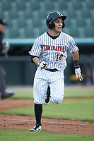 Nick Madrigal (10) of the Kannapolis Intimidators hustles down the first base line against the West Virginia Power at Kannapolis Intimidators Stadium on July 25, 2018 in Kannapolis, North Carolina. The Intimidators defeated the Power 6-2 in 8 innings in game one of a double-header. (Brian Westerholt/Four Seam Images)