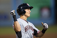 Jose Cardona (8) of the Hickory Crawdads reacts after driving in the first run of the game against the Asheville Tourists during Game Three of the South Atlantic League Championship at McCormick Field on September 17, 2015 in Asheville, North Carolina.  The Crawdads defeated the Tourists 5-1 to win the 2015 South Atlantic League Championship.  (Brian Westerholt/Four Seam Images)