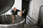 Brewmaster Tommy prepares the tanks for the filtering process. After the first addition of the malt and cooking of the ingredients, the beer will be transferred to this tank and the grains will be filtered out. The small brewery in Raervig, Denmark is a new brewery on the competitive scene of micro brewers in Europe.