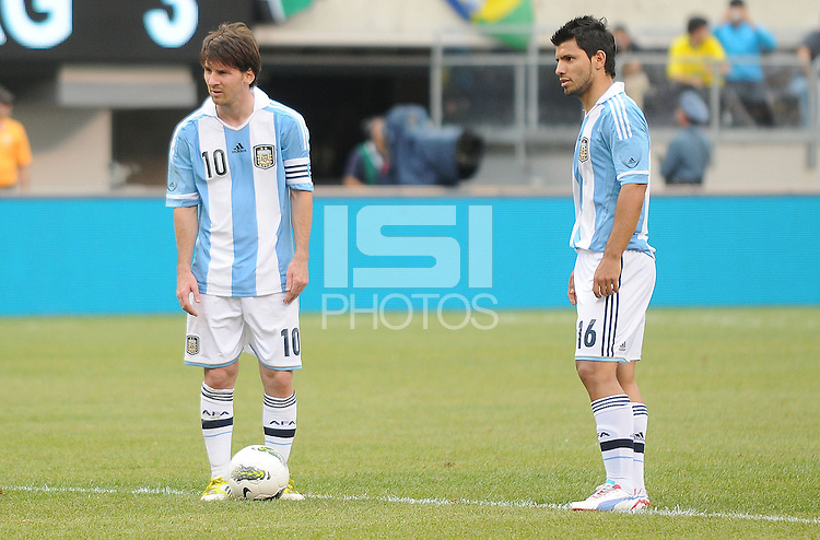Argentina forward Lionel Messi (10) with forward Sergio Aguero (16) during a free kick. The Argentina National Team defeated Brazil 4-3 at MetLife Stadium, Saturday July 9 , 2012.