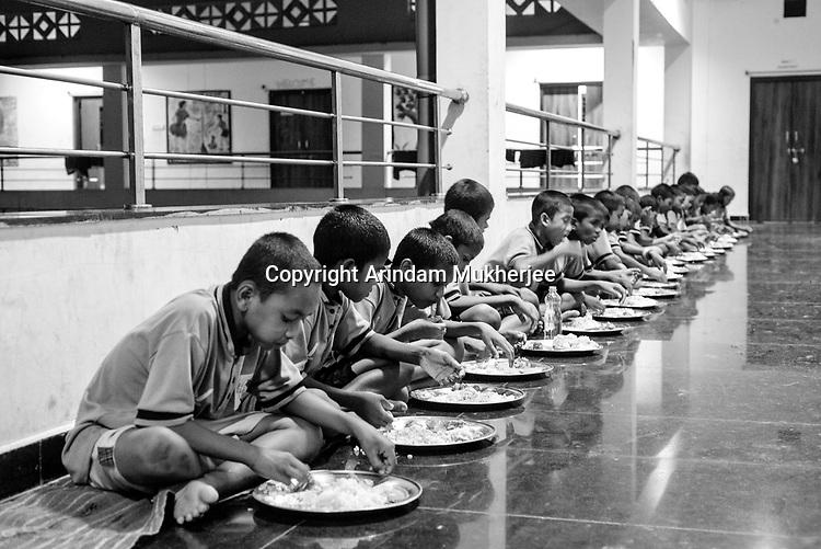 Boys having dinner free of cost at a canteen run by the government. Sukma, Chattisgarh, India. Arindam Mukherjee