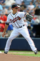 Atlanta Braves starting pitcher Kris Medlen #54 delivers a  pitch during a game against the Colorado Rockies at Turner Field on September 3, 2012 in Atlanta, Georgia. The Braves  defeated the Rockies 6-1. (Tony Farlow/Four Seam Images).