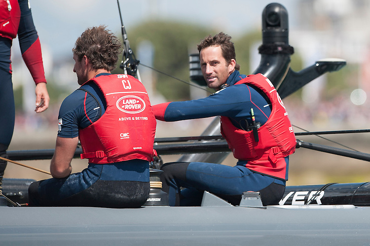 25 July 2015: Sir Ben Ainslie, skipper Land Rover BAR, is satisfied with a first and second in today's racing during the America's Cup first round racing off Portsmouth, England (Photo by Rob Munro)