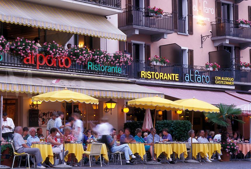 café, Switzerland, Ticino, Ascona, Lake Maggiore, Outdoor cafés along the lakefront in the city of Ascona at night.