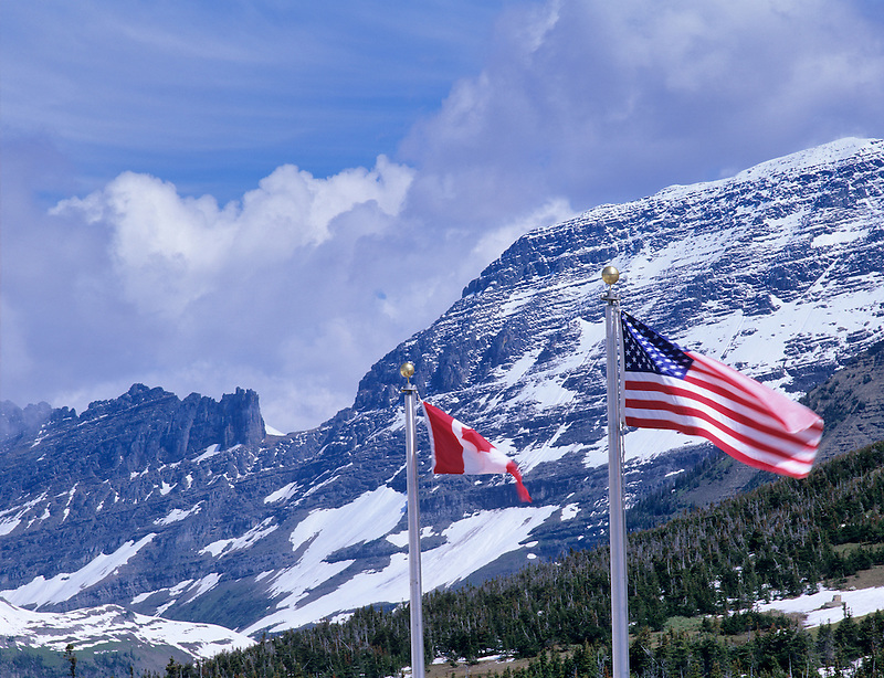 U.S. and Canada flags at visitors center at Logan Pass. Glacier National Park, Montana.