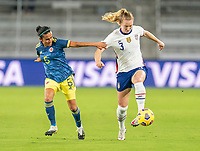 ORLANDO, FL - JANUARY 22: Ana Huertas #5 of Colombia fights for the ball with Samantha Mewis #3 of the USWNT during a game between Colombia and USWNT at Exploria stadium on January 22, 2021 in Orlando, Florida.