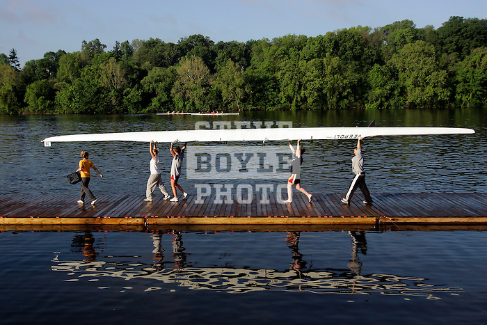 Rowers from the University of Charleston launch their Women's Varsity Heavyweight Four boat during the 68th Dad Vail Regatta on the Schuylkill River in Philadelphia, Pennsylvania on May 12, 2006......................