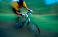 Blurred motion image of a mountain biker.