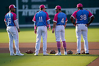 """Greenville Drive players wait for the start of a game against the Brooklyn Cyclones on Saturday, May 15, 2021, at Fluor Field at the West End in Greenville, South Carolina. Drive players were wearing jerseys for the """"Ranas de Rio de Greenville"""" (Greenville River Frogs), as part of Minor League Baseball's """"Copa de la Diversion."""" (Tom Priddy/Four Seam Images)"""
