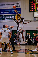 18 December 2018: University of Vermont Catamount Forward Samuel Dingba, a Redshirt Senior from Yaounde, Cameroon, takes the first overtime tip-off against the St. Bonaventure University Bonnies at Patrick Gymnasium in Burlington, Vermont. The Catamounts defeated the Bonnies 83-76 in a double-overtime NCAA DI game. Mandatory Credit: Ed Wolfstein Photo *** RAW (NEF) Image File Available ***
