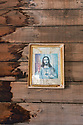 Spain - Andalusia - An image of Jesus Christ hanging on the wall of the church in Western Leone movie set.