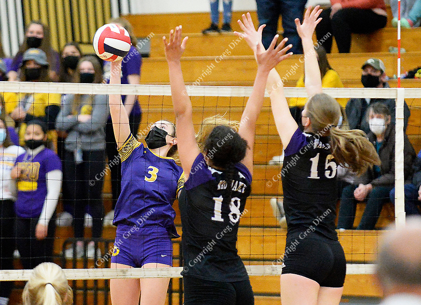 DeForest's Natalie Compe hits past Waunakee's Robyn Ryan (18) and Claire Holden (15), as DeForest tops Waunakee 3 sets to 1 in Wisconsin WIAA girls high school volleyball regional finals on Saturday, Apr. 10, 2021 at DeForest High School   Wisconsin State Journal article page C6 Sports Apr. 11, 2021 and online at https://madison.com/wsj/sports/high-school/volleyball/natalie-compe-norskies-win-regional-final/article_900df333-504a-56c8-abab-b9a29f42621a.html
