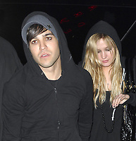 MIAMI BEACH, FL - JUNE 17, 2007: (EXCLUSIVE COVERAGE)  Singers Ashlee Simpson looks bored and depressed as she follows around Fall Out Boy Pete Wentz (AKA Peter Lewis Kingston Wentz III)  around Miami Beach, the couple seen here enterting their hotel where they stayed together  on June 17, 2007 in Miami Beach, Florida.  <br /> <br /> <br /> People:   Ashlee Simpson, Pete Wentz