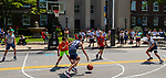 TORRINGTON CT 073121JS04 Kids play in a  3-on-3 basketball tournament on Main Street in front of Torrington City Hall during the Torrington PAL's Summer Fest in downtown Torrington on Saturday. The event included the annual Dress for Success backpack and school supply giveaway and other fun activities. <br /> Jim Shannon Republican American