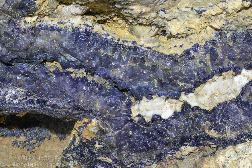 Vein of Blue John fluorite exposed by historical lead mining. Castleton, Peak District National Park, Derbyshire, UK.