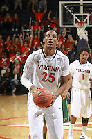 CHARLOTTESVILLE, VA- NOVEMBER 26:  Akil Mitchell #25 of the Virginia Cavaliers handles the ball during the game on November 26, 2011 at the John Paul Jones Arena in Charlottesville, Virginia. Virginia defeated Green Bay 68-42. (Photo by Andrew Shurtleff/Getty Images) *** Local Caption *** Akil Mitchell