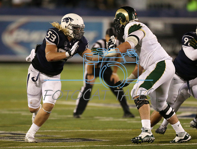 Nevada's Brock Hekking (53) and Colorado State's Ty Sambrailo (51) compete in an NCAA college football game in Reno, Nev., on Saturday, Oct. 11, 2014. Colorado State won 31-24. (AP Photo/Cathleen Allison)