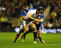 Tom Wood of England is tackled by Wesley Fofana (left) and Vincent Clerc of France during the RBS 6 Nations match between England and France at Twickenham on Saturday 23rd February 2013 (Photo by Rob Munro)