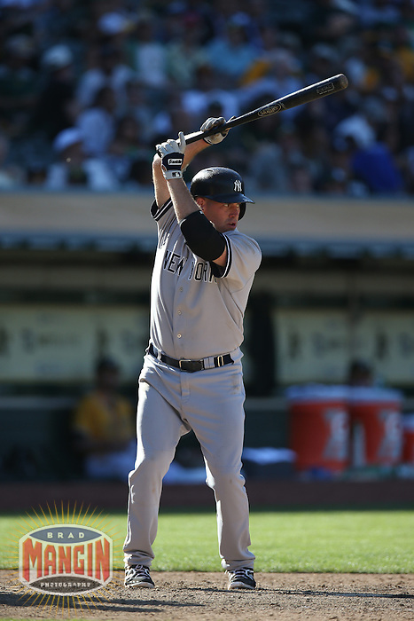 OAKLAND, CA - JUNE 13:  Kevin Youkilis #36 of the New York Yankees bats against the Oakland Athletics during the game at O.co Coliseum on Thursday June 13, 2013 in Oakland, California. Photo by Brad Mangin