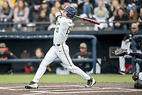 Michigan Wolverines designated hitter Dominic Clementi (13) follows through on his first inning home run against the Maryland Terrapins on April 13, 2018 in a Big Ten NCAA baseball game at Ray Fisher Stadium in Ann Arbor, Michigan. Michigan defeated Maryland 10-4. (Andrew Woolley/Four Seam Images)