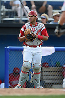 Batavia Muckdogs catcher Felix Castillo (47) checks the runner after retrieving a pitch in the dirt during a game against the Mahoning Valley Scrappers on August 24, 2014 at Dwyer Stadium in Batavia, New York.  Mahoning Valley defeated Batavia 7-6.  (Mike Janes/Four Seam Images)