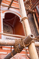 Jaipur, Rajasthan, India.  Fiber Cord Tying Bamboo Scaffolding in Place.