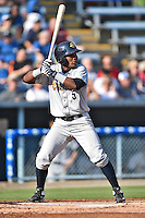 Charleston RiverDogs third baseman Miguel Andujar #5 awaits a pitch during a game against the Asheville Tourists at McCormick Field July 26, 2014 in Asheville, North Carolina. The RiverDogs defeated the Tourists 8-7. (Tony Farlow/Four Seam Images)