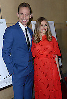 Elizabeth Olsen + Tom Hiddleston @ the premiere of 'I Saw The Light' held @ the Egyptian theatre.<br /> March 22, 2016