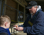 Dad Le Roy feeds son Jesse an oyster during the 28th annual Rocky Mountain Oyster Fry and St. Patrick's Day Parade in Virginia City, Nevada on Saturday March 16, 2019.