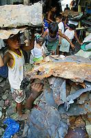 Baseco fire victims sell scrap metal to a junkshop. Bataan Shipyard and Engineering Company, Tondo, Manila. 13 January 2004