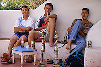 Tunisia, Sidi Bou Said.  Young Tunisian Men Smoking a Sheesha at the Cafe Sidi Sha'ban.