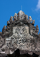 Cambodia, Angkor Wat.  Stone Carving above the Entrance to Stairs leading to the Second Level of the Temple.
